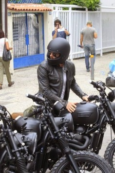 Found photo of David Beckham's blacked out Triumph Scrambler. He's wearing a @Biltwell Inc. Inc. Gringo helmet.