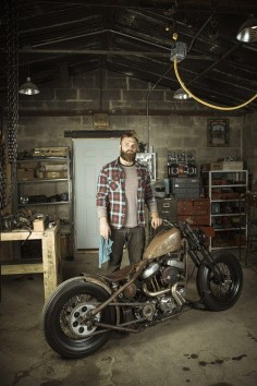 Harley Davidson bobber, built in his garage. That is one sexy man with his Harley.