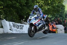 Ian Hutchinson (BMW - Tyco BMW) at Ballaugh Bridge during the RST Superbike TT race. DAVE KNEEN/PACEMAKER PRESS, BELFAST: 04/06/2016: