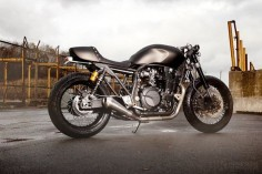 """I've always liked the Yamaha XJR1300. It's an uncomplicated bruiser of a bike, an unassuming retro-style naked powered by a air-cooled motor with a lineage over a quarter of a century long.    Yamaha knows that if it ain't broke, you don't fix it. But the XJR1300 is also ripe for a makeover, so the Japanese factory called in the Wrenchmonkees. The result is MonkeeFist, the first in a series of """"Yard Built Specials"""" commissioned by Yamaha from leading custom builders."""