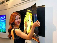 LG unveils a 55-inch wallpaper OLED TV that hangs on the wall with magnets | Inhabitat - Sustainable Design Innovation, Eco Architecture, Green Building