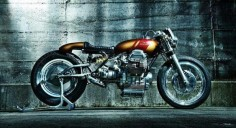 Moto Guzzi custom with monoshock rear-end, small tank and wasp-like rear cowl