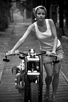 Not a rider - check the skirt and shoes - def a model - still a cool bike and photo