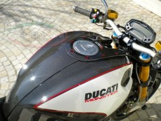 Painted carbon fiber gas tank cover on Monster 1100.