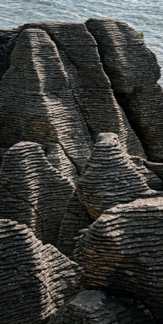 Punakaiki is on the road between Westport and Greymouth and is a geological feature of stratified rock formations created more than 30 million years ago. The feature is known as the Pancake Rocks - NZ