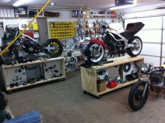 Rolling motorcycle work bench. Could be made to roll under workbench on the wall for storage and out of the way when not in use.