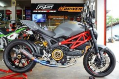 Satin grey Ducati Monster 796 with a low slung titanium SC Project 2-1 exhaust and a Ducabike clutch cover