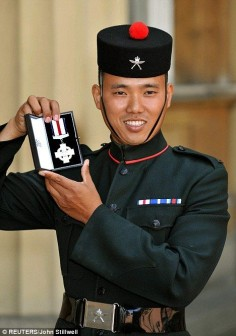 SERIOUS badassery here! Cpl Pun, from the 1st Battalion the Royal Gurkha Rifles, receives Conspicuous Gallantry Cross @ Buckingham Palace. Total he fired off 250 machine gun rnds, 180 SA80 rnds, 6 phosphorous grenades, 6 reg. grenades, 5 underslung grenade launcher rounds & 1 Claymore. The only weapon he did not use was the traditional Kukri knife carried by Gurkhas because he did not have his with him at the time. He'll catch hell over that one! Still The enemy did NOT over run his