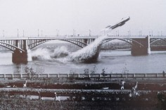Soviet Air Force pilot Valentin Privalov flies his jet fighter under a bridge on the river Ob, in Siberia, June 4th, 1965.
