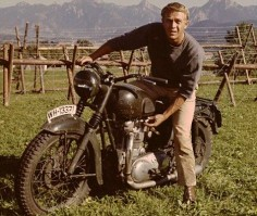 Steve McQueen in The Great Escape. They dressed up a Triumph to look like a German bike. One of the coolest motorcycle chase scenes put to film.