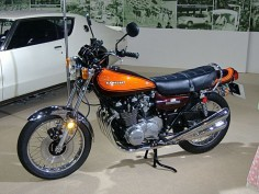 "The Kawasaki Z1 was developed in strict secrecy under the project name ""New York Steak"".[8][9] In the late 1960s Kawasaki, already an established manufacturer of two-stroke motorcycles, decided to make a 750 cc four-cylinder four-stroke sports motorcycle[2] (they even had an appearance prototype designed by McFarlane Design in 1969),[11] but they were beaten to the marketplace by the Honda CB750. This postponed the Z1′s release until its displacement could be upped to 903 cc.[2]"