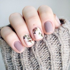 This #nail design is so cute. I love the #purple nail polish and the #floral design. | @ANDWHATELSEISTHERE