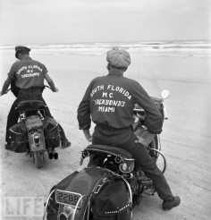 Two members of the Vagabonds Motorcycle Club (South Florida) maneuver their non-racing, single-seat hogs on the Daytona sands. For decades, the bikes that routinely won the Daytona 200 bore brand names like Indian, Norton, and Harley-Davidson. (1948)