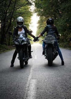 Two women crossing paths on a motorcycle ride