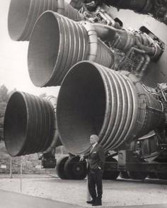 Werner von Braun standing in front of the Saturn V rocket in Rocket Park,  Space & Rocket Center, Huntsville, AL