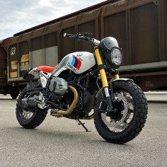 Word on the street is that BMW will soon launch a scrambler version of the R nineT. We're hoping it looks as good as this Dakar-themed custom from @Luis Moto of Italy. He's reworked the R nineT into a modern version of the iconic R80G/S Paris Dakar, complete with motorsport graphics and that classic red seat. And the stainless steel, two-into-one exhaust system is absolutely … Fantastisch. #MakeLifeARide #scrambler Get the full specs and high-res images at