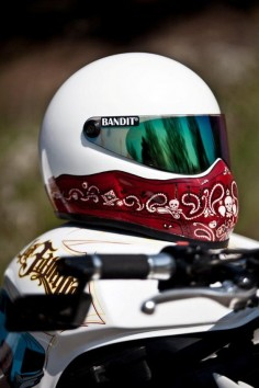has some info on how to clean a motorcycle helmet and keep it looking new.