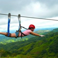 Zip lining in Costa Rica, scary but WAY  Supermanning over the forrest