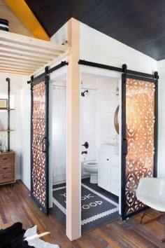 400  Small Boho-style House in Austin - it's two tiny houses on wheels put together. Check-out this bathroom - the double barn doors!