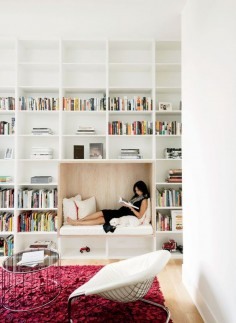 A cozy reading nook in a spacious home library.