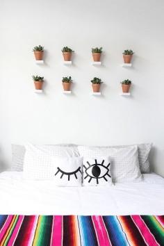 a wall o' teeny tiny shelves for plants.