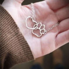 Admit it: they have left their paw prints on your heart! The simplicity of our linked heart and paw necklace is all you need to convey the love you have for your furry companions.