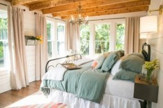 All of the original windows were retained and given new window treatments. The hardwood floors were restored and all of the original shiplap exposed and painted white. Unpainted wood ceiling and exposed wood beams help distinguish the space and provide a warming accent.