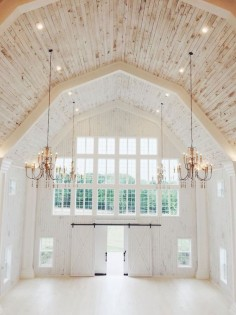 Amazing ceiling. Love the shape of the roof , the wood on ceiling and white below and the two beautiful chandeliers.