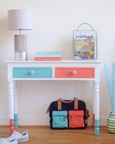 An otherwise ordinary piece of furniture can be given a new lease on life with a quick lick of paint. You don't have to go all out -- dipped legs and painted drawer fronts are all that's needed to make an impact with this entryway console.