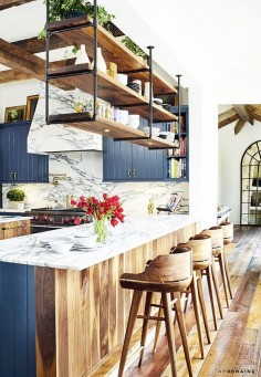 """As for the color scheme, Decker went room by room and favored liberal experimentation in pursuit of landing the perfect hue. """"We went through several paint colors in the kitchen."""