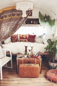Beautiful living room decor - patterned pillows, lots of candles and vintage furniture.