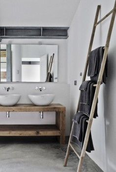 Beautiful timber creates a rustic look for this bathroom! Love timber ladders for hanging towels and magazines on!