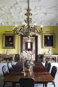 Classic English country dining room with lemon walls