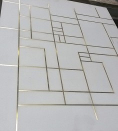 Concrete floor tiles with brass inlay