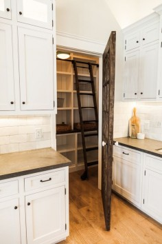 Custom pantry with rolling library ladder - by Rafterhouse.