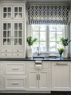Dark floors and countertops, and white cabinets. Light but still has that good dark color in it to ground it well: