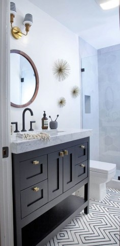 Dark wood and light marble bathroom vanity