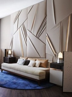 Dramatic wall paneling in this living room in the AD France designer show house.