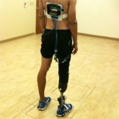"""Feedback System Lets Amputees """"Feel"""" Prosthetic Leg. A sensorized shoe insole translates pressure into tactile feedback, helping amputees learn to walk on a prosthetic limb with a normal, healthy gait."""