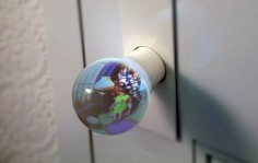 Fisheyed Glass Globe Doorknobs - the globe on your end of the door provides a wide-angle view of what's on the other side, which is achieved by collecting and reflecting light soaked up by another globe on the other end.