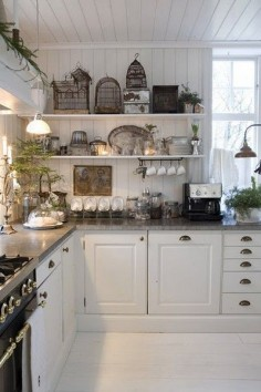 FRENCH COUNTRY COTTAGE: Vintage Kitchen . Love the bird  add a old world charm.