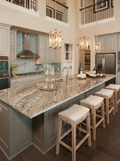 Gorgeous two story kitchen, granite countertops, pendant lighting, blue mosaic backsplash tile, grey cabinetry, extra large island | Five Star Interiors