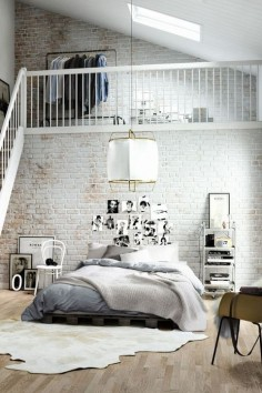 Heart the white loft brick, heart the animal skin rug, heart the light fixture. Rad bed too.
