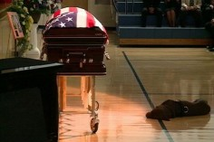 "i cried when i read this ---Slain Navy SEAL Jon Tumilson's DOG ""Hawkeye"" lies next to his casket during funeral services in Rockford, Iowa. Tumilson was one of 30 American soldiers killed in Afghanistan on August 6 when their helicopter was shot down during a mission to help fellow troops who had come under fire."