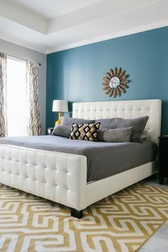 I love the different colours use, especially the grey with the turquoise and yellow accent -- Blue master bedroom