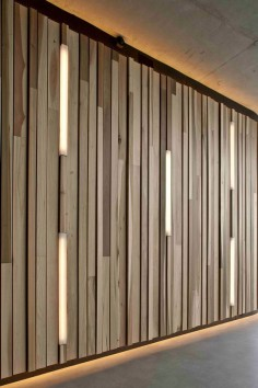 I love the wooden wall feature with inset light strips and top/bottom lighting.
