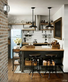 Inside an industrial loft space recently updated in Bulgaria. The space features black steel, exposed brick, dark wood and concrete panels.