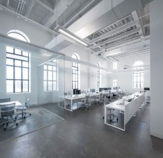 Jean Guy Chabauty of Moderno and Anne Sophie Goneau teamed up to create a new office space for BLUE Communications, an interactive agency based in Montreal. Located in an old brewery, the office space was a little under 3,000 square feet and needed to be updated to reflect the firm's creative nature, specializing in web development, branding, content creation, social media, and apps.