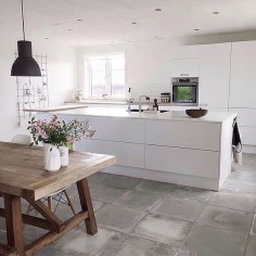 Just love the kitchen + dining of @Simone Østergård - white on white kitchen, concrete floors and that table