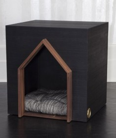 KELLY WEARSTLER | BEAU DOG HOUSE. Composed of ebonized ribbed walnut and adorned with burnished bronze insignia.